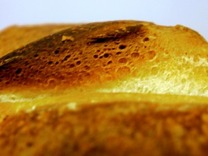 The crust of a loaf of white buttermilk country bread