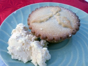 A mince pie with brandy butter on the side.