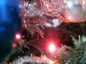 Baubles, tinsel and Christmas lights on a Christmas tree