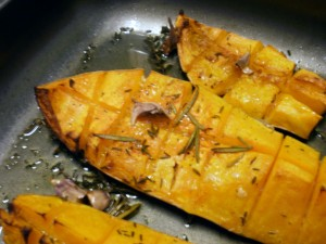 Roasted pieces of butternut squash with garlic and herbs