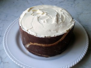 Completed joconde imprime cake with brown and white sponge, topped with Chantilly cream