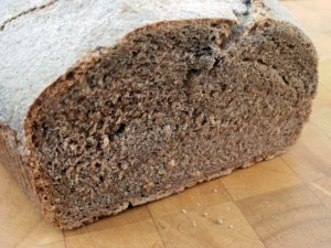 A sliced loaf of spelt bread showing the crumb.