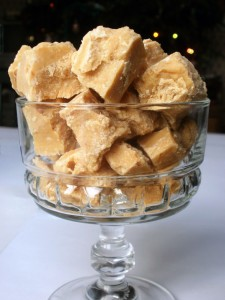 Pieces of white chocolate fudge in a glass.