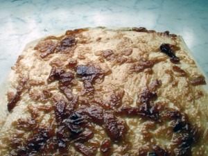 Caramelised onions spread on puff pastry to make palmiers.