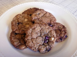 A plate of pomegranate and white chocolate chip cookies