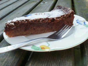 A slice of Nigella's flourless chocolate lime cake with a fork