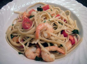 A plate of garlic, prawn and spinach linguine.