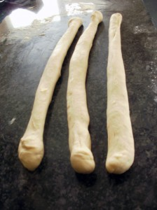 three strands of bread dough, ready to be plaited.