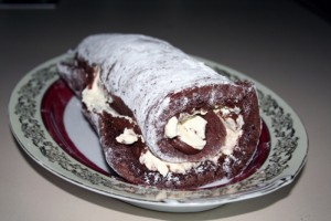 Chocolate yule log on a plate