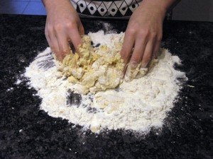 Rubbing butter and egg into plain flour to make pate brisee pastry dough