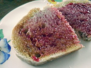 A slice of toast spead with raspberry curd