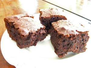 Three chocolate brownies on a plate