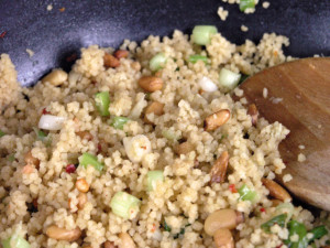 Couscous in a pan with spoon